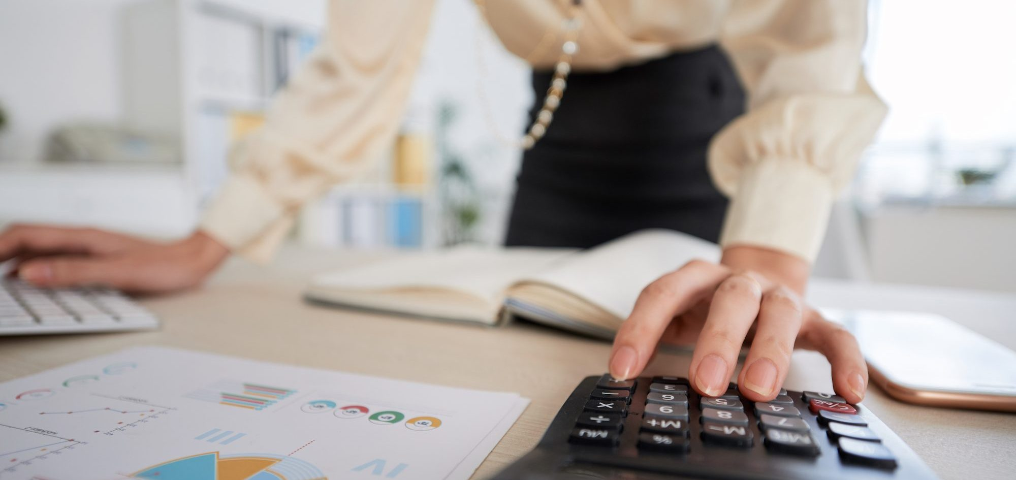 Bookkeeper making calculations | Focused Energy Outsourced Finance Accounting