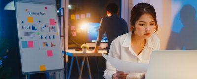 business woman reviewing profitability statements | focused energy outsourced cfo services | denver, colorado